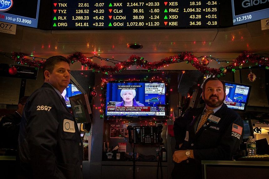 Traders at the New York Stock Exchange are all ears as Fed chairman Janet Yellen announced the raising of interest rates for the first time in almost a decade this month.
