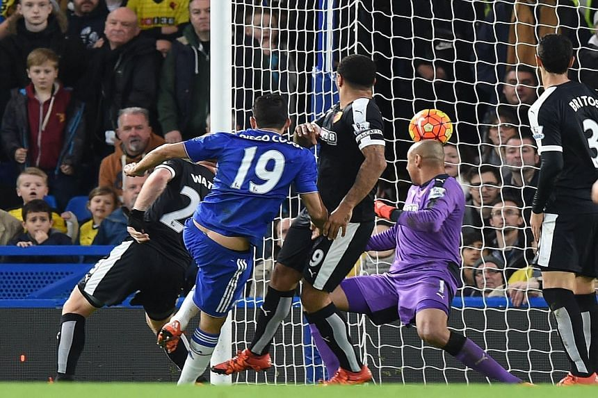 Diego Costa scoring the opening goal against Watford. Guus Hiddink's first match in charge of the Blues ended in a 2-2 draw.