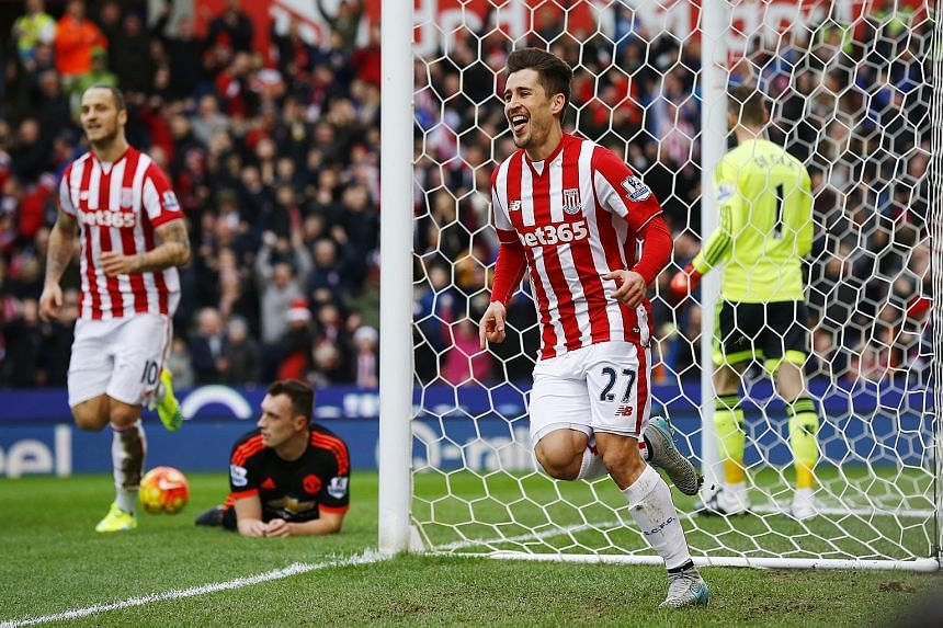 Above: The anguish of Manchester United manager Louis van Gaal is laid bare as his men fail to contain the Potters. Left: Bojan Krkic (No. 27) celebrating after scoring the first goal in Stoke City's 2-0 Premier League victory over United at Britanni