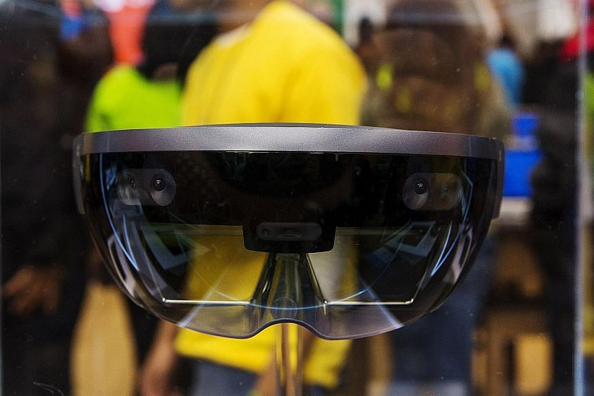The Vive has a tracking system that allows the user to roam while using it. The Rift needs to be connected to a powerful computer and a separate tracking sensor. Microsoft's HoloLens blends 3D virtual visuals with the real world to create an augmente