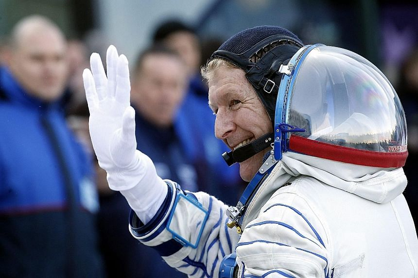 British astronaut Timothy Peake waving goodbye before his flight to the space station.