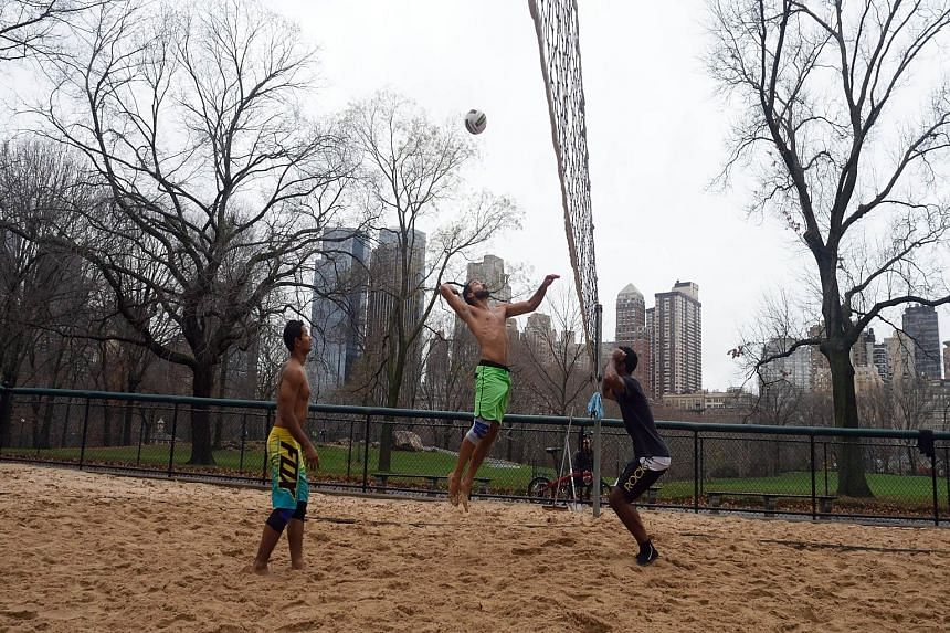 A group of men taking advantage of the warmth to play volleyball in New York's Central Park as temperatures peaked at 22 deg C last Thursday, the warmest Christmas Eve since records began in 1871.