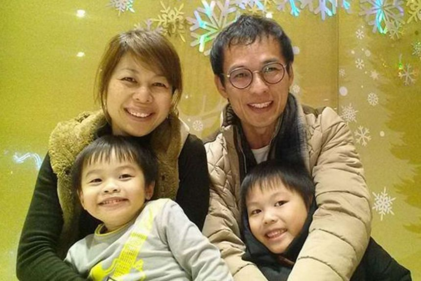 Mr Barnabas Lim (top right) posing for a photo with his wife Kristen Ng and two sons Rayshon (bottom right) and Evan.
