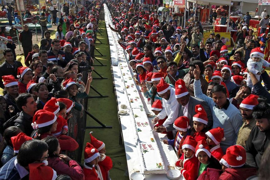 Christmas comes but once a year so these folks are having their cake - a 76m-long one - and eating it, during Christmas celebrations at a consumer fair in Chandigarh, India.