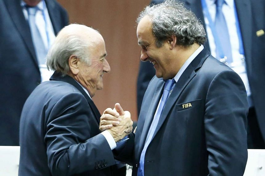 Uefa president Michel Platini (right) and Fifa president Sepp Blatter have been handed eight-year bans from all football-related activities after an ethics probe. PHOTO: REUTERS