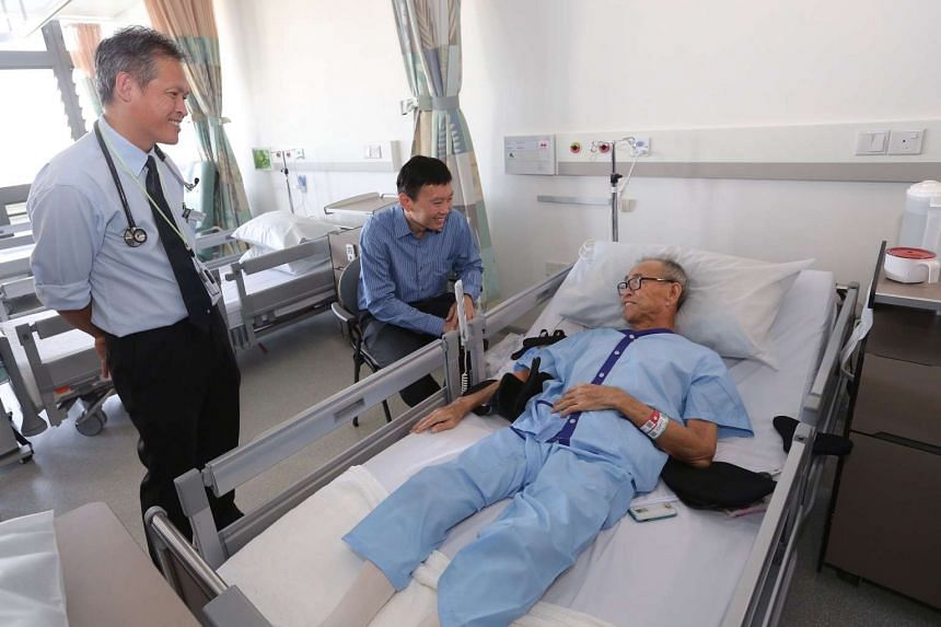 Minister of State for Health Mr Chee Hong Tat (centre) speaks to Mr Lim Yang Kiyau (right), 66, at Ward D97 of Yishun Community Hospital.