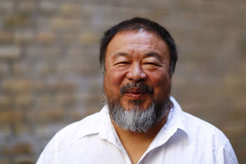 """Chinese dissident artist Ai Weiwei said he was """"very proud"""" of the """"civilised"""" welcome that Germany has accorded to refugees."""