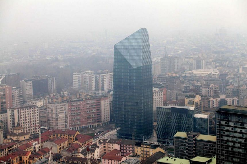 An aerial view of skyscrapers area of Milan, Italy, as it is surrounded by smog on Dec 26, 2015.