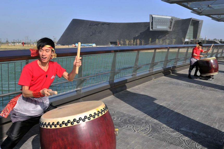 Drummers performing on opening day in front of the new National Palace Museum branch in Chiayi on Dec 28, 2015.
