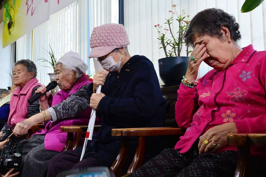 """Former South Korean """"comfort woman"""" Lee Ok-sun speaks as the others react at a special shelter for former """"comfort women""""."""