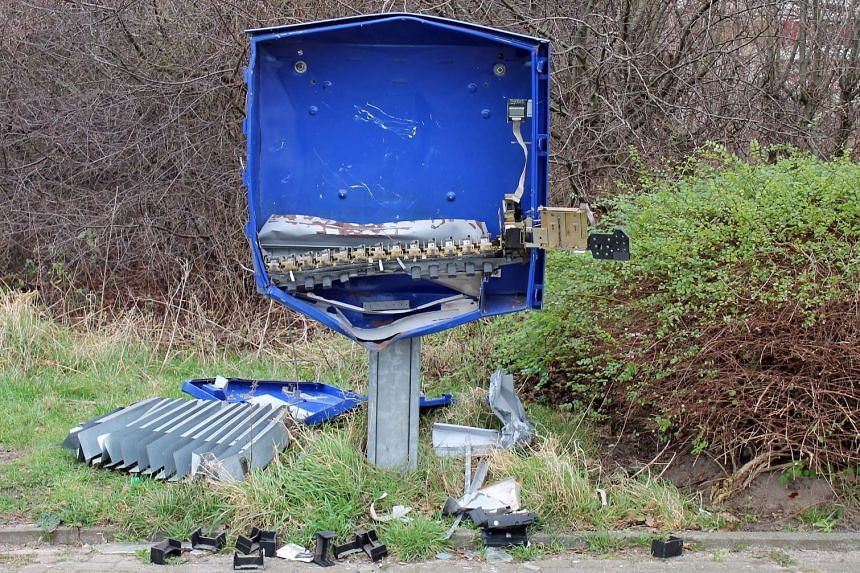 The remains of the condom dispenser after it was blown up in a suspected robbery attempt, in Schoeppingen, Germany, on Dec 26, 2015.