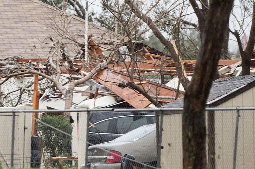 Damages are seen after a tornado hit Garland, Texas on Dec 27, 2015.