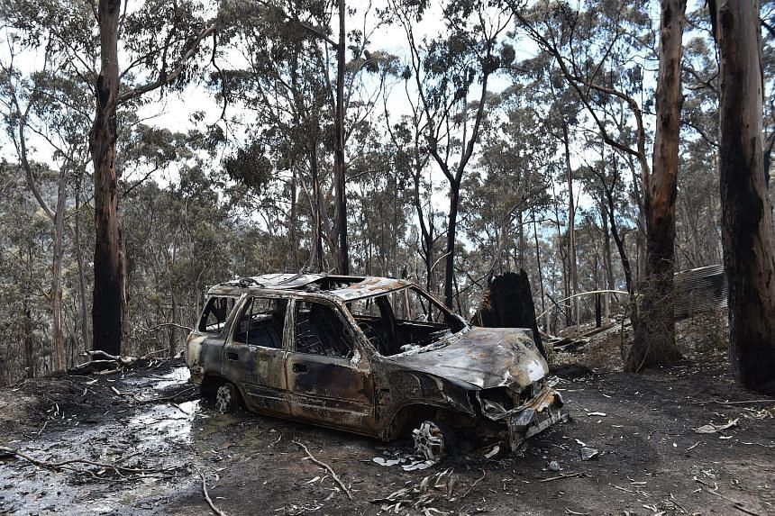 A fire damaged car is seen at Wye River in the Otway Ranges south of Melbourne, Australia, on Dec 27, 2015.
