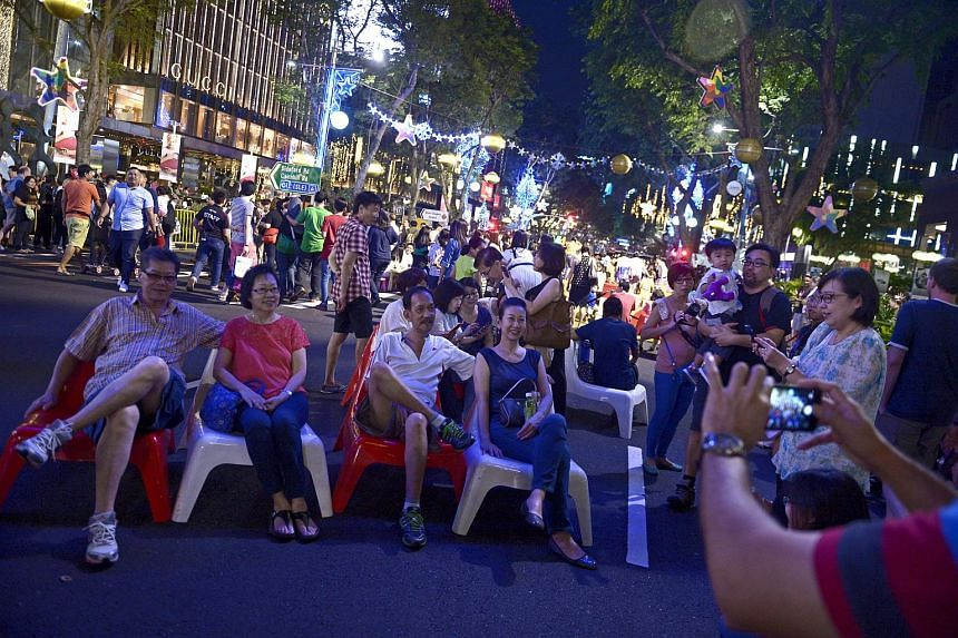 Visitors posing for pictures and enjoying street performances at the Pedestrian Night on Orchard Road on Jan 3, 2015.