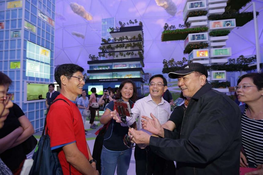 Minister Heng Swee Keat welcoming the first group of visitors to the Future Of Us exhibition at Gardens by the Bay on Dec 1, 2015.