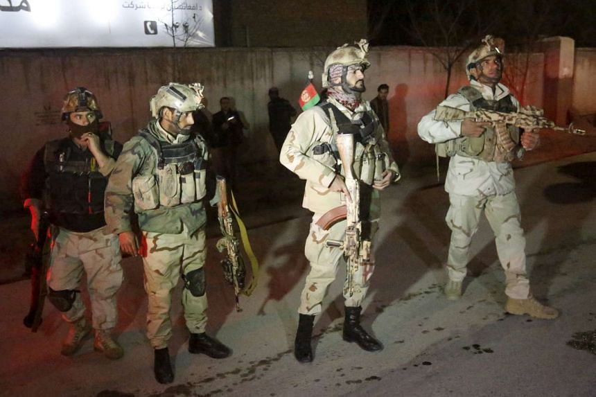 Members of an Afghan Crisis Response Unit (CRU) standing guard at the site of a Taleban attack in Kabul, Afghanistan, on  Dec 11, 2015.