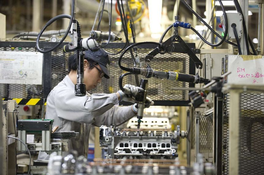 A Mazda automobile corporation worker assembles rotary engines at the company's main factory in Hiroshima.