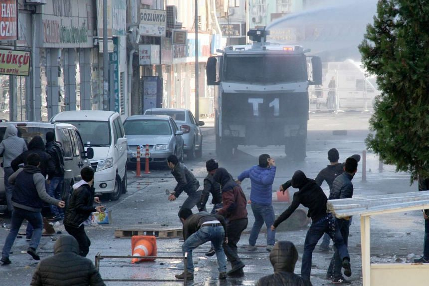 Turkish police deploy water canons to disperse protesters during a protest against the Turkish Government's ongoing security operations in the east of Turkey, in Diyarbakir, Turkey, on Dec 22, 2015.