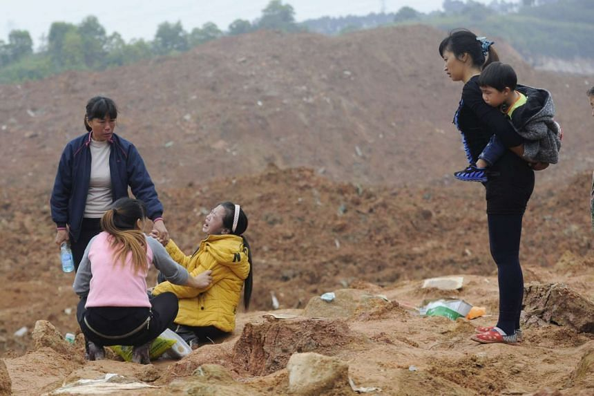 A woman whose relatives are missing cries at the site of a landslide in Shenzhen.