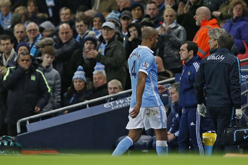 Manchester City's Vincent Kompany goes off injured during the Barclays Premier League football match against Sunderland.
