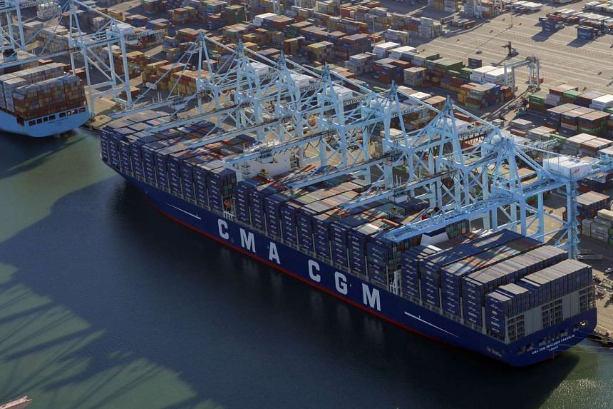 The CMA CGM Benjamin Franklin, the largest container ship to ever call at a North America port, is docked at the Port of Los Angeles in California after arriving before dawn on Dec 26.