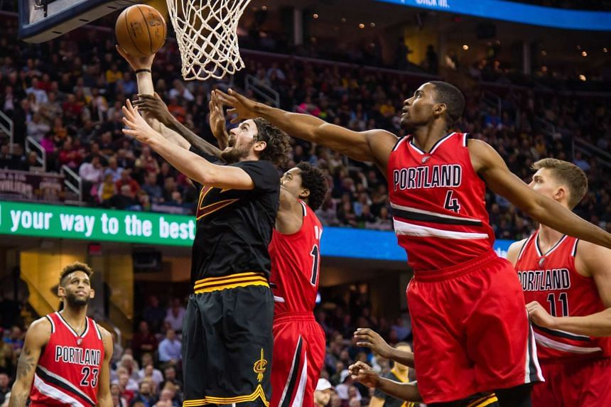 Kevin Love #0 of the Cleveland Cavaliers shoots while under pressure from Maurice Harkless #4 of the Portland Trail Blazers.