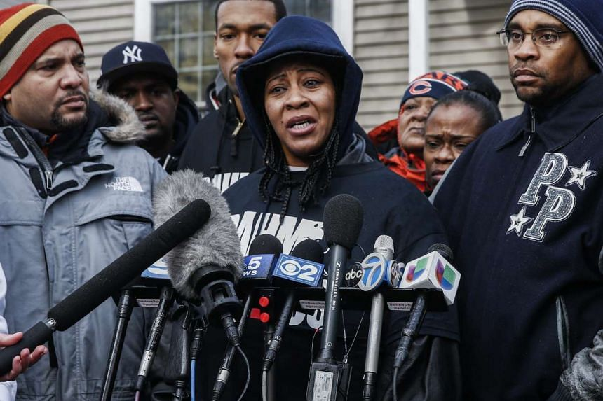 Janet Cooksey (centre), the mother of 19 year old Quintonio LeGrier speaks to the media as she stands with relatives and neighbours outside the location where Chicago police were called to a domestic disturbance that resulted in the shooting death of