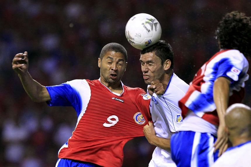 Costa Rica's Alvaro Saborio (left) fights for the ball with El Salvador's Alfredo Pacheco during their 2014 World Cup qualifying soccer match at the national stadium in San Jose in this 2012 file photo. Alfredo Pacheco, a soccer player who played for