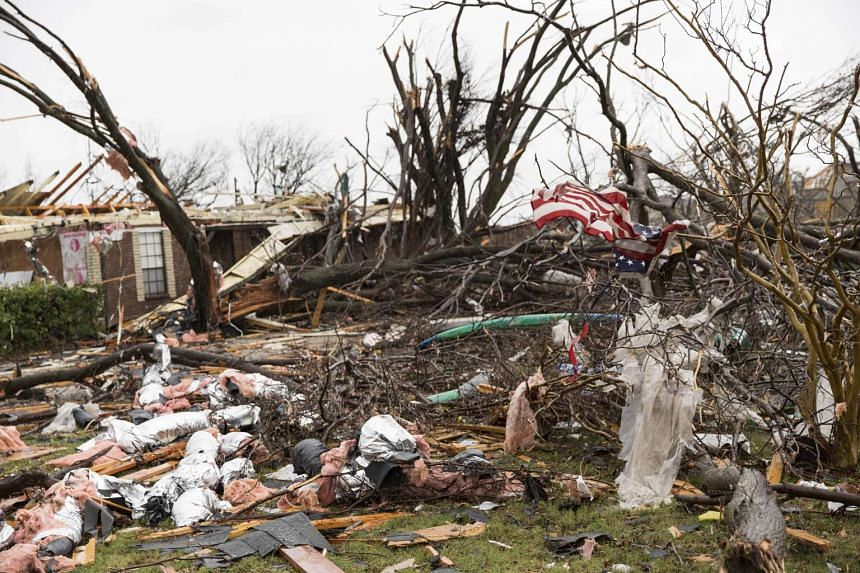 An American flag placed by first responders is seen amid the debris of destroyed houses in Rowlett, Texas, in the aftermath of a tornado, on Dec 27, 2015.