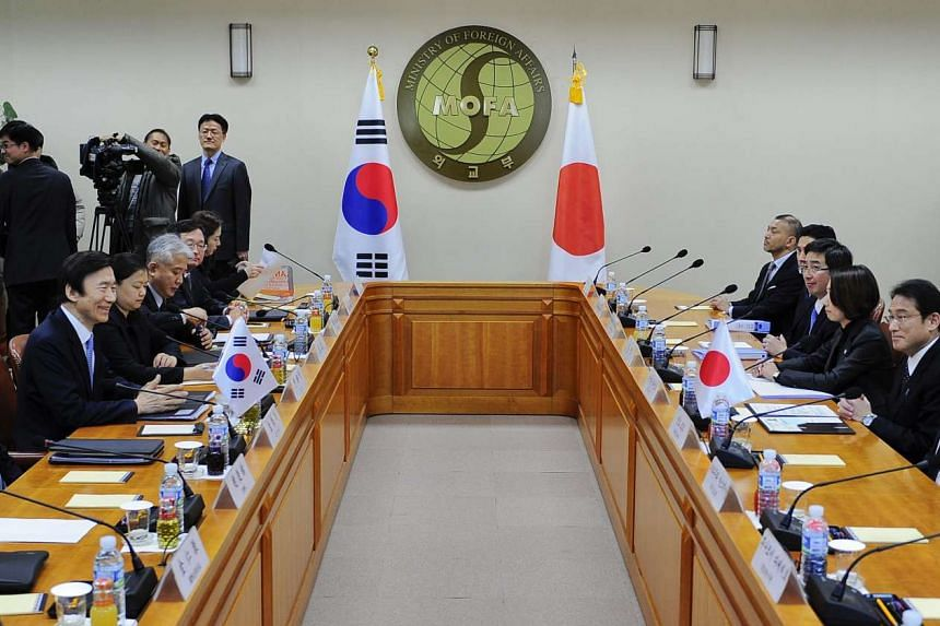 Japanese Foreign Minister Fumio Kishida (2nd from right), talks with South Korean counterpart Yun Byung Se (2nd from left) during their meeting at the Foreign Ministry in Seoul, South Korea, on Dec 28, 2015.