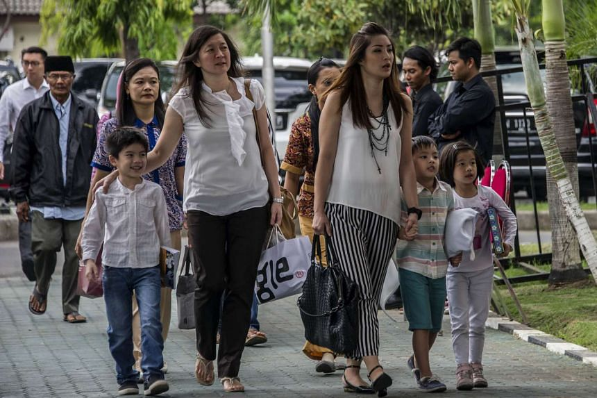 Families of Air Asia victims arrive at police headquarters in Surabaya on Dec 28, 2015.