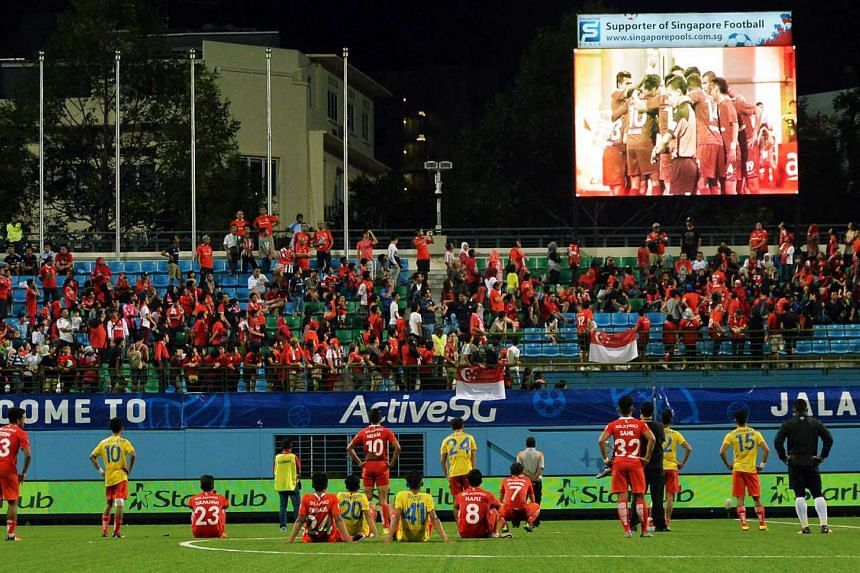 LionsXII players and fans watching a video clip after the Malaysia Cup quarter final, second leg match against Pahang.