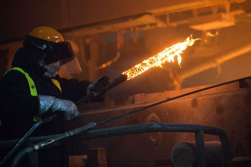 An employee at the Celsa Steel UK steel mill plant in Cardiff, Britain on Nov 18.