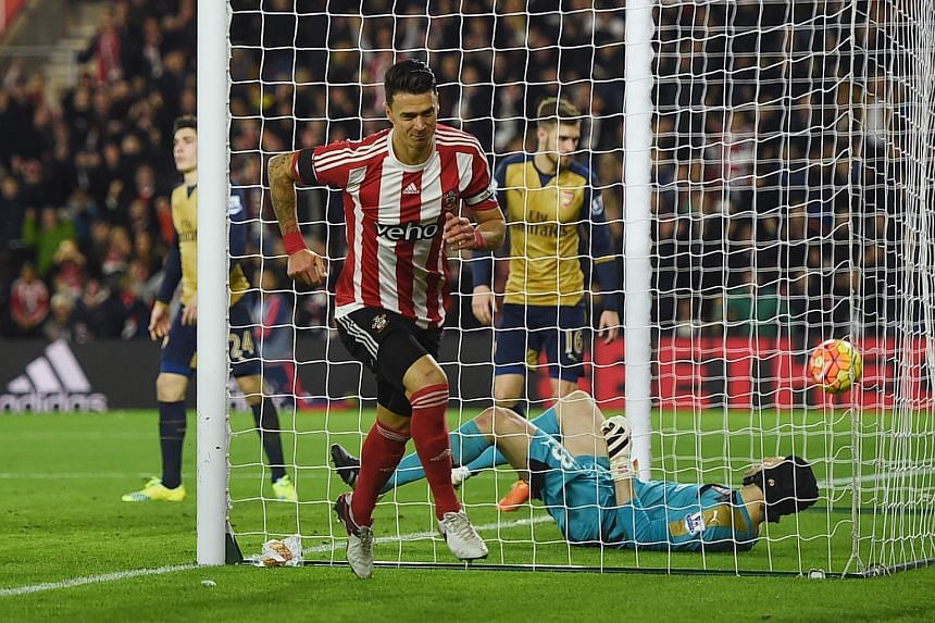 Southampton's Jose Fonte celebrating after scoring his side's third goal in the stunning 4-0 win against Arsenal on Boxing Day. Despite Arsenal failing to take top spot in the Premier League, Arsene Wenger rejected former England boss Glenn Hoddle's