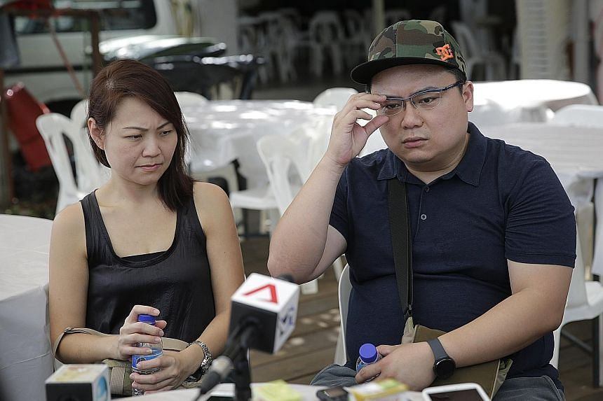 The boy's aunt, Ms Ng Khai Hiang, and her husband Darius Liew speaking to the media yesterday at the wake. Evan's maternal grandparents are caring for him now, although relatives have not finalised his long-term living arrangements.