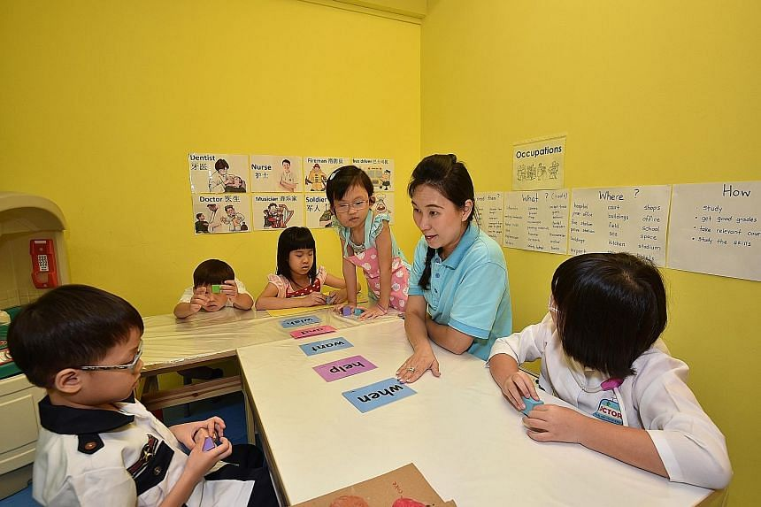 Ms Grace Tan with her pupils. She said those who attend the Little Bosses Boot Camp will be able to use the skills they have learnt to make the transition to primary school, where they will be handling real money on their own for the first time.