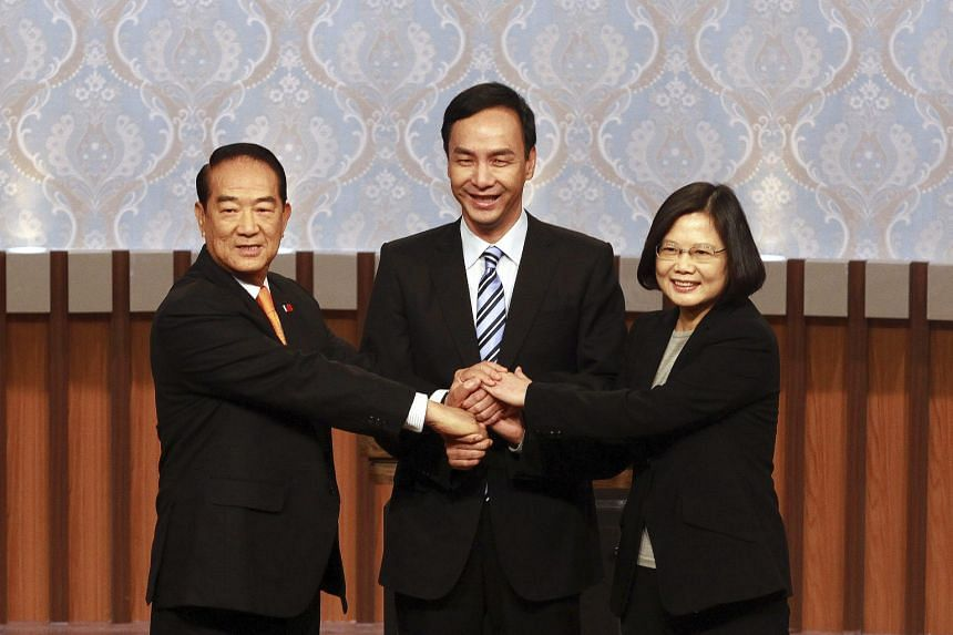 (From left) People First Party's James Soong, KMT's Eric Chu and DPP's Tsai Ing-wen at the start of their first televised presidential debate in Taipei yesterday.
