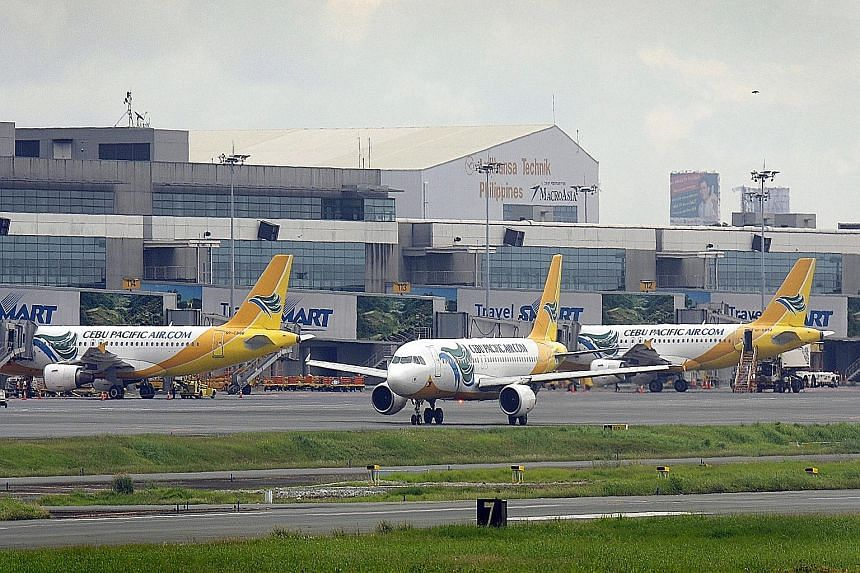 Planes at Manila's Ninoy Aquino International Airport. The Philippines has removed restrictions from all cities except its capital Manila, while Indonesia has opened up only Jakarta. The other eight Asean countries, including Singapore, have lifted a