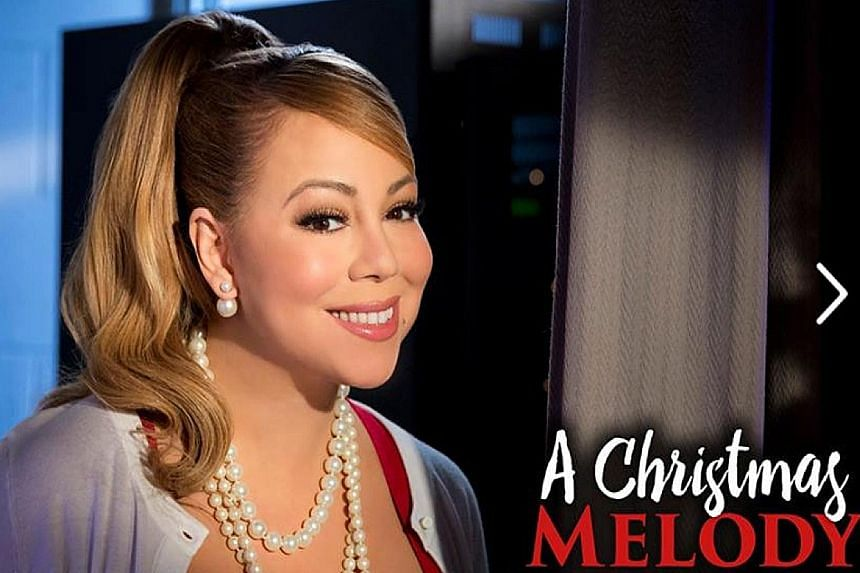 Singer Mariah Carey (above) directed and stars in A Christmas Melody.