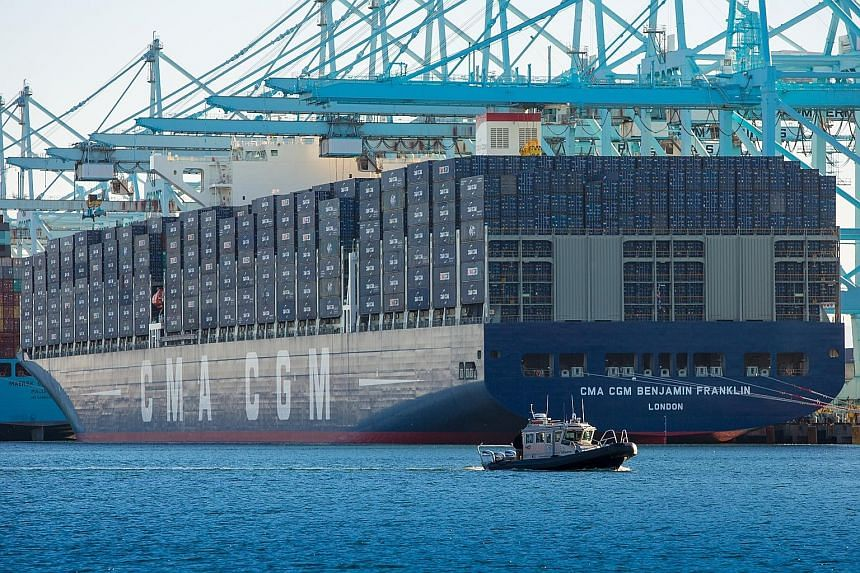 The Benjamin Franklin, operated by French container company CMA CGM, sits docked at the Port of Los Angeles in California on Saturday. It is the largest container vessel to call at a United States port. It is longer than the Empire State Building lai