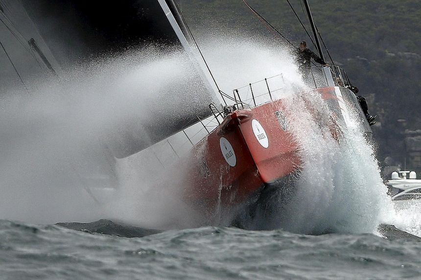 Maxi yacht Comanche powering through heavy swells at the start of the 71st Sydney to Hobart race. Defending champion and eight-time line honours winner Wild Oats XI was among the 23 boats that had dropped out by yesterday.