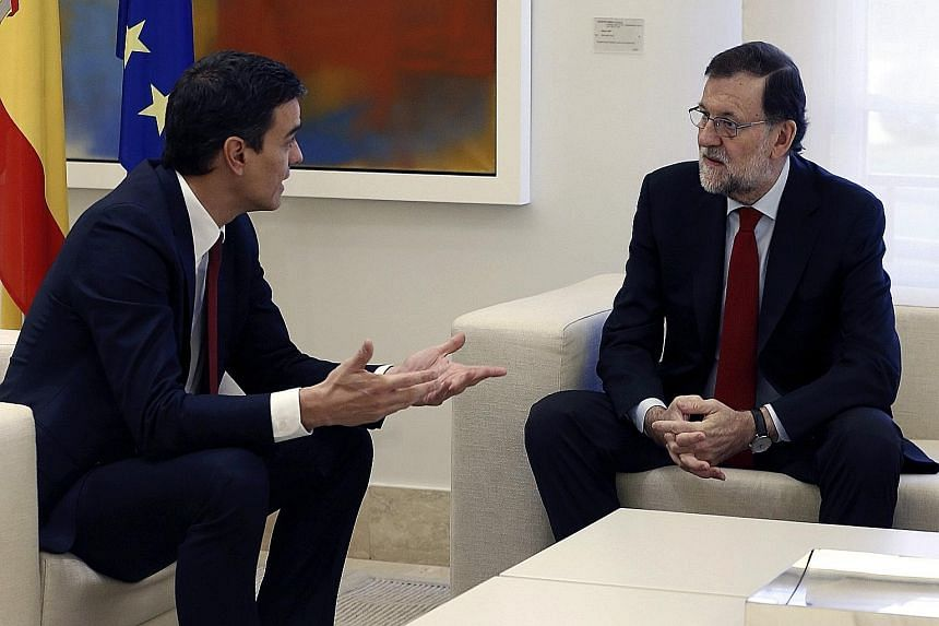 Prime Minister Mariano Rajoy (right) meeting Socialist leader Pedro Sanchez at the Palace of La Moncloa in Madrid last Wednesday to discuss the situation after the Dec 20 election. Mr Rajoy hopes to form a coalition government after his Popular Party