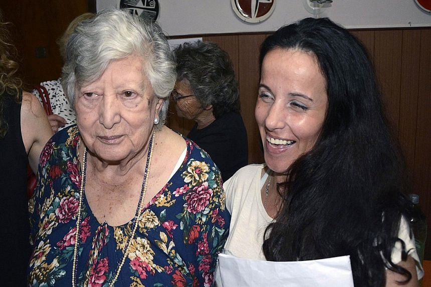"""Argentinian activist Maria """"Chicha"""" Mariani on Christmas Eve with the woman originally identified as her granddaughter Clara Anahi."""