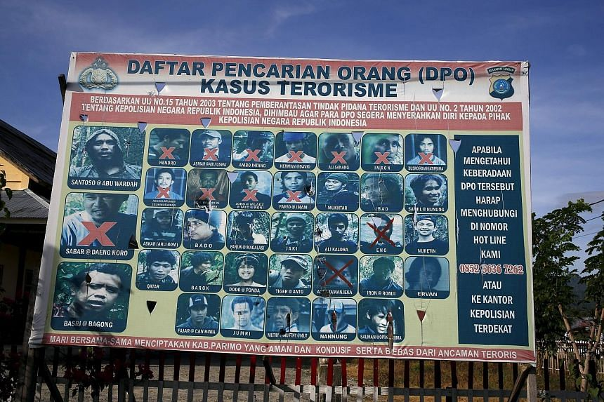 An Indonesian police billboard on Dec 19 showing a list of militants, including Indonesia's most wanted man Santoso (top left). Complaints against intolerant views spread on air have risen, with local television stations being the biggest target of n
