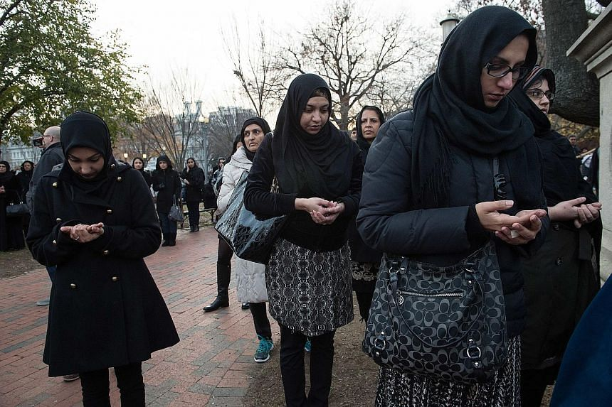 Muslim women praying during an anti-terrorism demonstration outside the White House this month. It is a difficult time to be a Muslim woman in the United States, especially one wearing a headscarf.