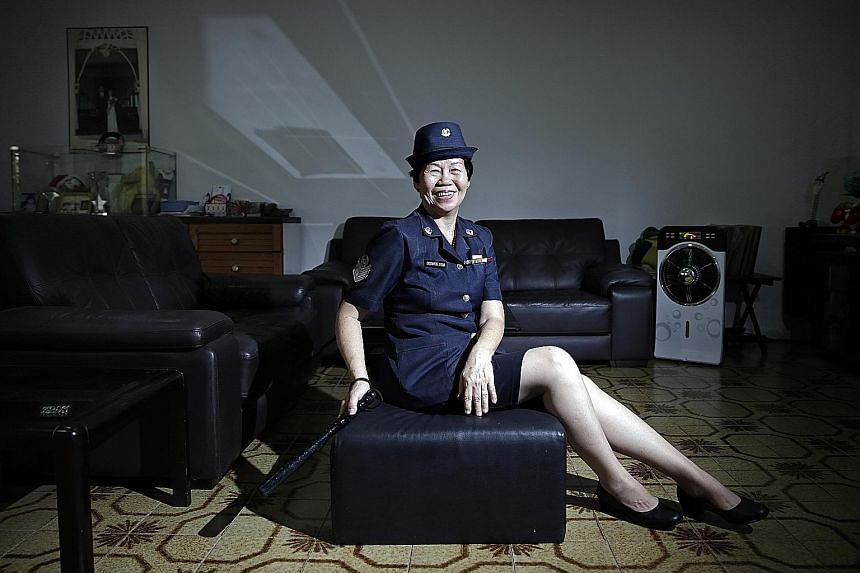 """Madam Wong, who joined the police force in 1963 and retired in 1994, in her old police uniform. Recalling the SQ117 hijacking on March 26, 1991, she said: """"I thought they were joking and I scolded the guy who called me. I said, don't play a fool. How"""