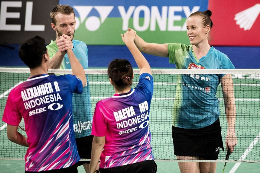 Danish Carsten Mogensen (back, left) and Kamilla Rytter Juhl (back, right) shaking hands with Ronald Alexander (front, left) and Melati Daeva Oktaviani (centre) from Indonesia after defeating them during the Yonex Copenhagen Masters 2015 on Dec 27, 2