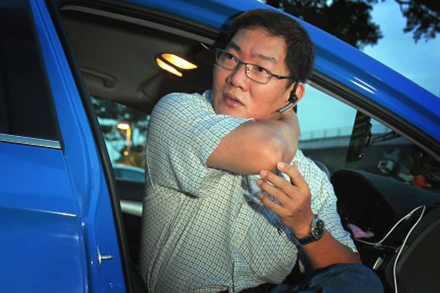 Taxi driver Chan Chuan Heng showing how Arne Corneliussen held him in a chokehold.