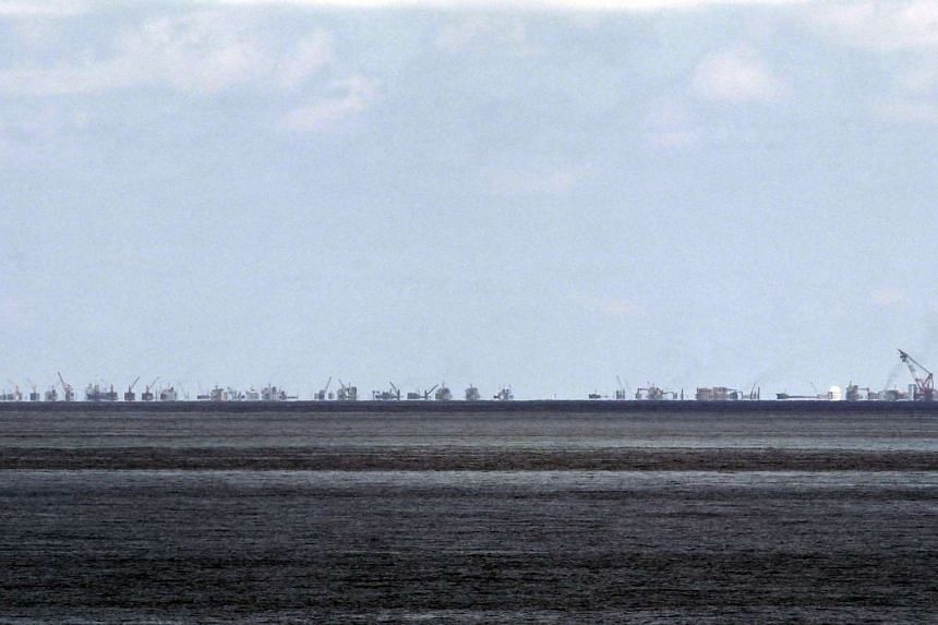 The alleged ongoing land reclamation by China at Subi Reef is seen from Pagasa Island, known internationally as Thitu Island, in the Spratlys group of islands in the South China Sea.