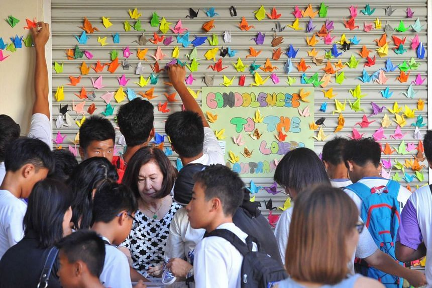 Paper cranes being put up on a wall at Tanjong Katong Primary School to pay tribute to the victims of the Sabah earthquake.